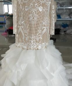 C2020-Talley-385 Long Sleeve fit-and-flare bridal gown with ruffles from Darius Cordell